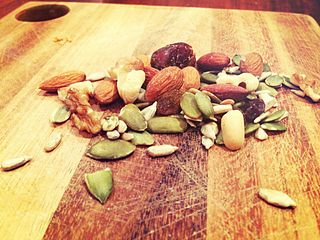nuts and dried fruits on a cutting board