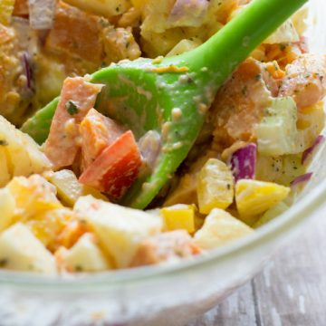 image of super sweet potato salad by intentionally eat with Cindy Newland in a glass bowl with a green spoon