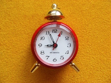 A red alarm clock