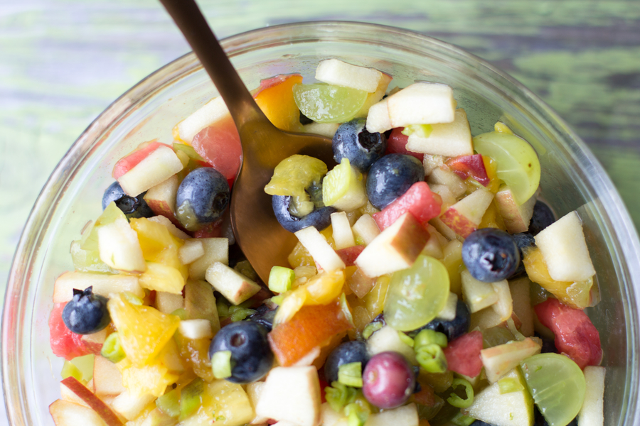 image of creamy fruit salsa by intentionally eat with cindy newland a glass bowl full of fruit with a gold spoon