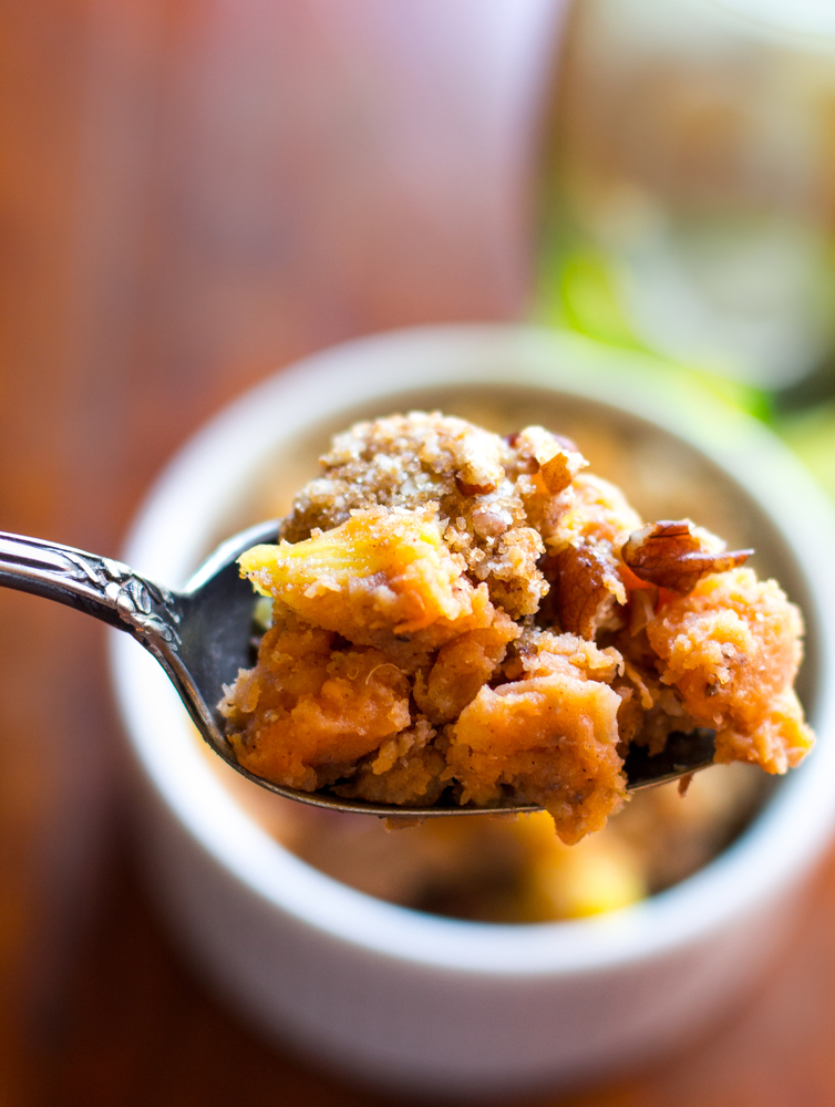 image of best ever sweet potato casserole by intentionally eat a wooden spoon full.