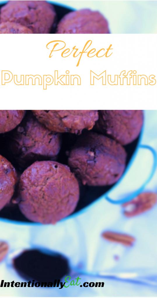 mini pumpkin muffins displayed in a blue bucket