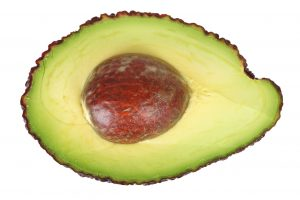 half of an avocado with the pit