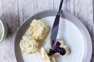 image of the best healthy biscuits by intentionally eat with blueberry preserves on a plate with a knife