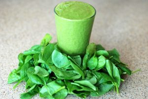 image of a shamrock shake surrounded by spinach leaves