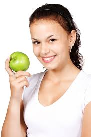 image of woman holding a green apple