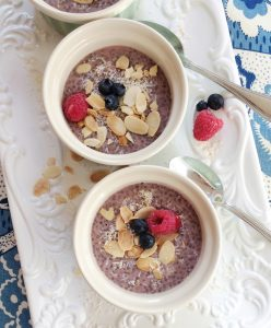 image of two bowls of chocolate chia pudding topped with berries and nuts for 8 rules for clean eating