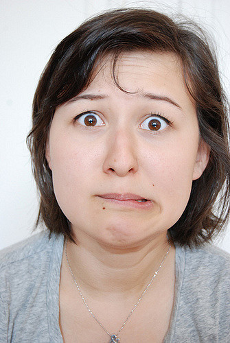 image of a woman with brown hair looking confused for ow to start working out by intentionally eat