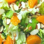 image of green salad with mandarin oranges, snow peas, almonds, crispy noodles