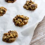 image of Irresistible apple pie protein cookies by intentionally eat with cindy newland on parchment paper on a white barn wood table