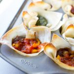 image of crunchy taco cups that are healthy by intentionally eat in a mini muffin tin with salsa and yellow peppers