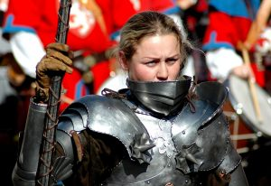 woman wearing armor and holding a spear for healthy living devotional is stinking thinking sabotaging your health by intentionally eat