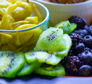 Image of sliced kiwi, peppers and berries for 7 best meal prep hacks by intentionally eat