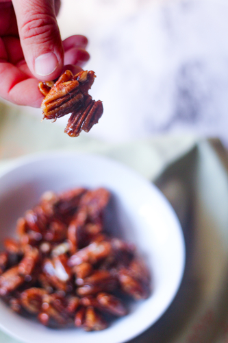 image of hand holding cinnamon candied nuts by intentionally eat
