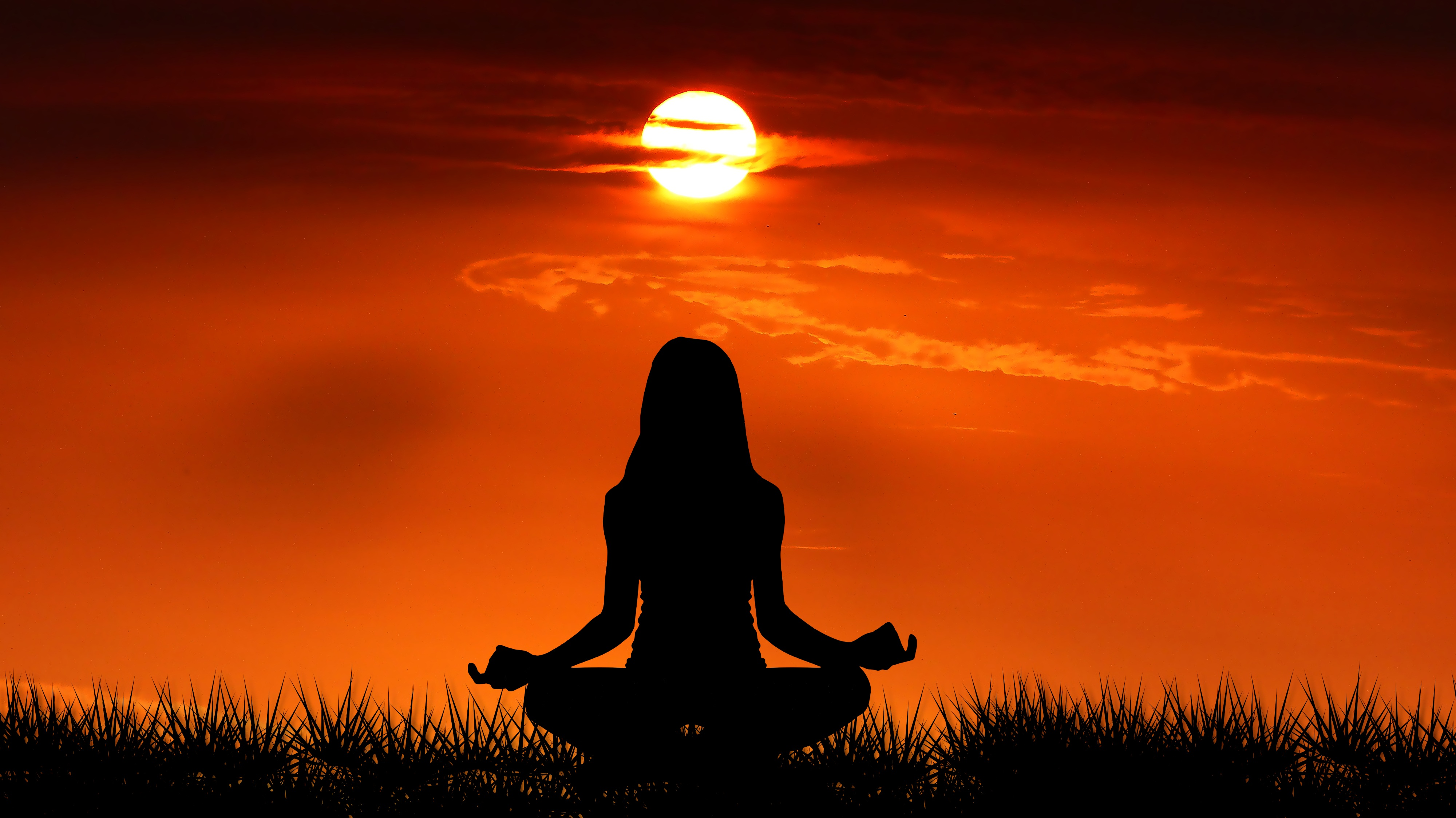weekend wellness retreat with cindy newland image of woman in lotus pose at sunrise