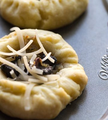 image of savory mushroom tarts by intentionally eat with Cindy Newland in a muffin tin
