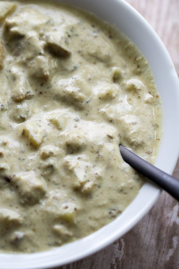 image of clam-less vegan chowder by intentionally eat with cindy newland in a white bowl with a black spoon