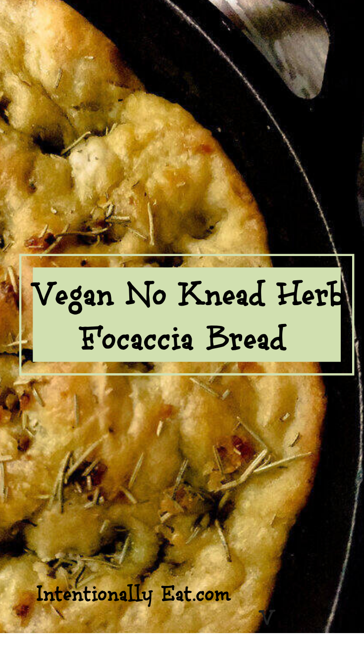 image of vegan no knead herb focaccia bread by Intentionally Eat with Cindy Newland in a cast iron skillet