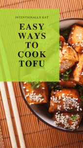 image of a pin for pinterest for easy ways to cook with tofu. The pin shows a bowl of fried tofu sprinkled with sesame seeds on a bamboo mat with chopsticks.